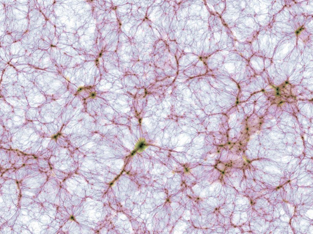"""Dünner Schnitt durch die kosmische Großraumstruktur in der größten Simulation des Illustris-TNG Projekts. Die Bildhelligkeit zeigt die Massendichte und der Farbton die mittlere Gastemperatur der herkömmlichen (""""baryonischen"""") Materie. Die dargestellte Region erstreckt sich von links nach rechts über 1.2 Milliarden Lichtjahre. Die zugrunde liegende Rechnung ist die gegenwärtig größte magneto-hydrodynamische Simulation der Galaxienentstehung und verfolgt die Entwicklung von mehr als 30 Milliarden Volumenelementen und Materieteilchen. Bild: IllustrisTNG"""